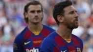Bringen viel Geld in Bewegung: Antoine Griezman durch Transfersummen, Lionel Messi (rechts) durch Gehälter.