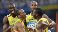Ein Pekinger Gold weniger: Usain Bolt (l.) muss wegen Nesta Carter (r.) eine Goldmedaille zurückgeben