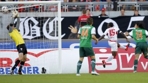 Pizarro of Werder Bremen scores during their German Bundesliga first division soccer match against goalkeeper Lehmann of VfB Stuttgart in Stuttgart