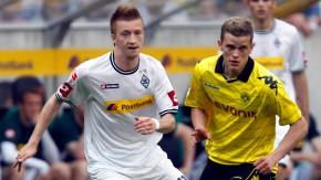 Aus Gegnern werden Mitspieler: Reus im Duell mit dem Dortmunder Sven Bender