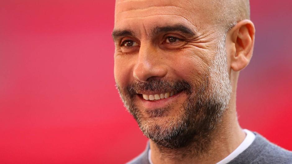 Grund zum Strahlen: Pep Guardiola holt mit Manchester City den Titel.