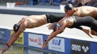 Gut geschwommen: Christian Reichart, Isabelle Franziska Harle und Rob Muffels holen Gold