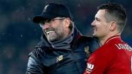 Ach, du schöne Fußball-Welt: Jürgen Klopp (links) mit Dejan Lovren nach dem Sieg mit Liverpool.