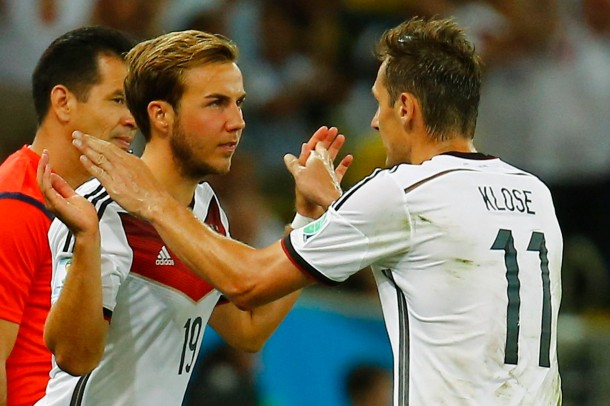 Germany's Klose greets his substitute, Goetze , as he leaves the pitch during their 2014 World Cup final against Argentina at the Maracana stadium in Rio de Janeiro