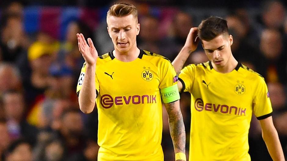 Ratlos in Barcelona: BVB-Kapitän Marco Reus (Mitte) und Julian Weigl