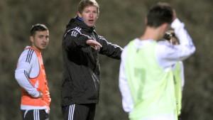 Ein Bundesligatrainer im Spagat