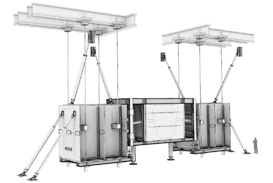 Jeder der beiden Dämpfer besteht aus zwei containergroßen Stahlgewichten, die mit Federarmen an der Decke des Raumes befestigt sind.