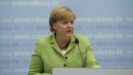 EU-Politiker und Märkte begrüßen Entscheidung für Sparplan
