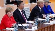 Angela Merkel, Xi Jinping und Donald Trump auf dem G-20-Treffen im vergangenen Jahr in Hamburg