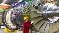 Am ganz großen Rad drehen: Siemens will künftig auch den Mittelstand in eine vernetzte Zukunft mitnehmen.