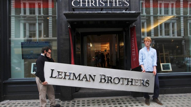 File photo of Christie's employees posing with a Lehman Brothers sign at Christie's in central London