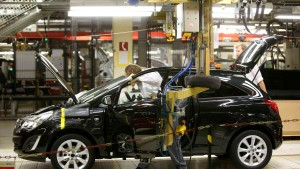 An employee works on an Opel car at the Opel factory in Eisenach