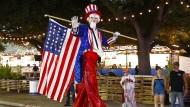 Uncle Sam ist obenauf: Die amerikanische Wirtschaft wächst schneller als gedacht kurz vor der Präsidentenwahl.