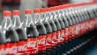 Coca-Cola verdient weniger