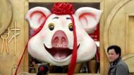 Dieses Schwein in Peking hat gut lachen.