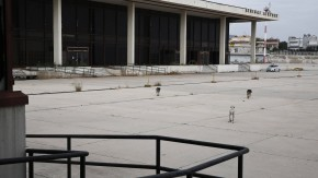 Stray dogs walk outside the former Athens International airport, Hellenikon