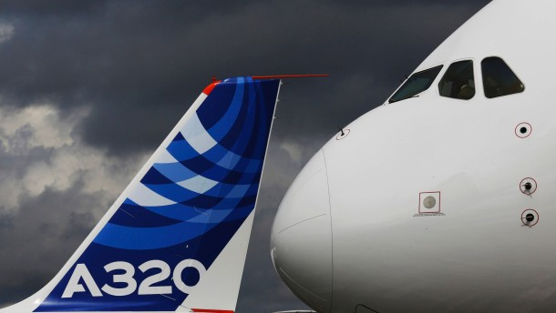 File photo of the nose cone of an Airbus A380 next to the tail fin of an Airbus A320 at the Farnborough Airshow 2012 in southern England