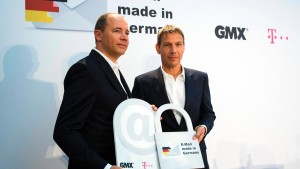 Deutsche Telekom CEO Obermann and United Internet CEO Dommermuth hold symbolic locks as they present encrypted email initiative in Berlin