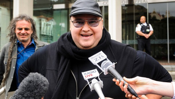 Megaupload founder Dotcom talks to members of the media outside the New Zealand Court of Appeals in Wellington