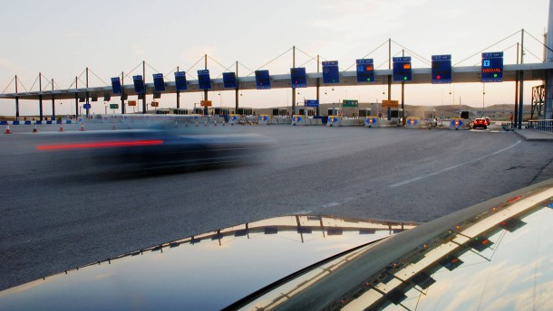 Toll booths at sunset. Toll motorway R-2. Madrid province. Spain.