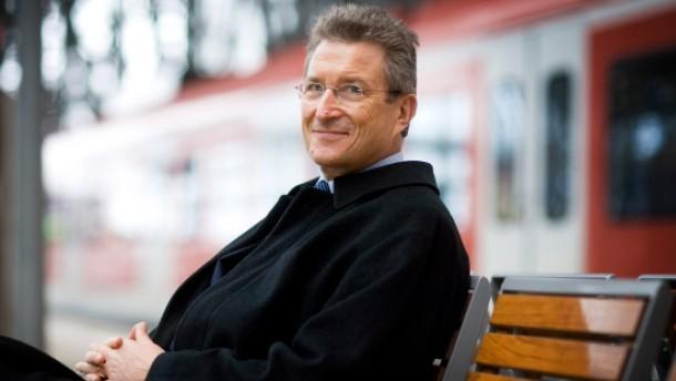 Huber zwischen Kirche und Kapital