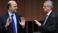 Moscovici (links) verantwortete die zu hohen Defizite Frankreichs. Jetzt will er in die EU-Kommission von Juncker (rechts).