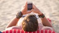 Im Urlaub oder Auslandssemester? Kein Problem - Spotify können Verbraucher demnächst einfach mitnehmen.
