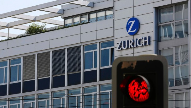 The logo of Swiss insurance group Zurich is seen behind a red traffic light on a building in Bern