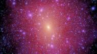 Projezierte Dichte der Dunklen Materie in einer simulierten Galaxie mit der Größe der Milchstraße. Myriaden von Klumpen aus Dunkler Materie kreisen in dem Halo der Galaxie.