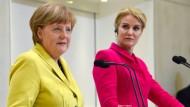 Merkel pocht trotz Widerstand auf Flüchtlingsquoten