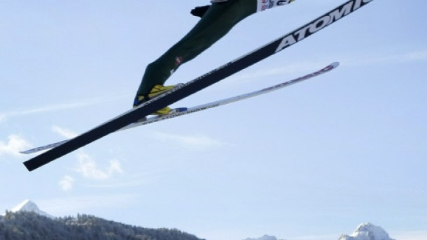 Germany''s ski jumper Michael Neumayer soars through air to take the third place in the second event of Four-Hills ski jumping tournament in Garmisch-Partenkirchen