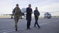 Cameron sagt Hollande Unterstützung zu