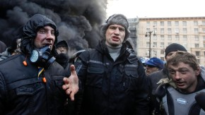 Opposition leader Vitaly Klitschko talks with pro-European integration protesters at the site of clashes with riot police in Kiev
