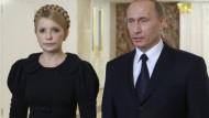 Offiziell einig: Die Regierungschefs der Ukraine und Russlands, Julia Timoschenko und Wladimir Putin