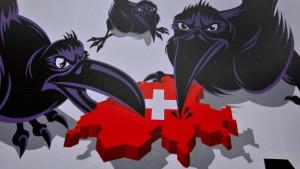 Schwarze Schnäbel  zerstückeln die Schweiz