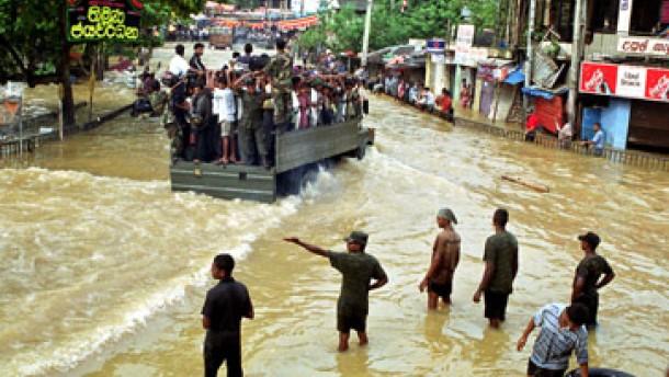 Zahlreiche Tote bei Überschwemmungen in Sri Lanka und China