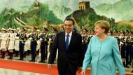Merkel fordert mehr Rechtssicherheit für deutsche Firmen in China